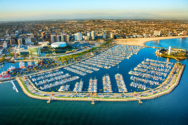 Long Beach California Aerial Aerial view of the Long Beach marina with adjacent to the buildings of downtown along the Pacific Ocean in Southern California. long beach california stock pictures, royalty-free photos & images