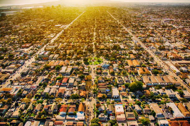 Long Beach California Aerial The expansive urban sprawl of Long Beach, California at dusk shot from an altitude of approximately 2000 feet during a helicopter photo flight. long beach california stock pictures, royalty-free photos & images