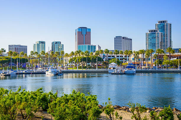 Long Beach California skyline and ShoreLine Aquatic Park Long Beach California ShoreLine Aquatic Park, waterfront and skyline long beach california stock pictures, royalty-free photos & images
