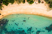 Long Beach on Koh Rong Samloem island in Cambodia, South-East Asia. top view, aerial view of a beautiful tropical island in Gulf of Thailand. With copy space texture for holiday design background.