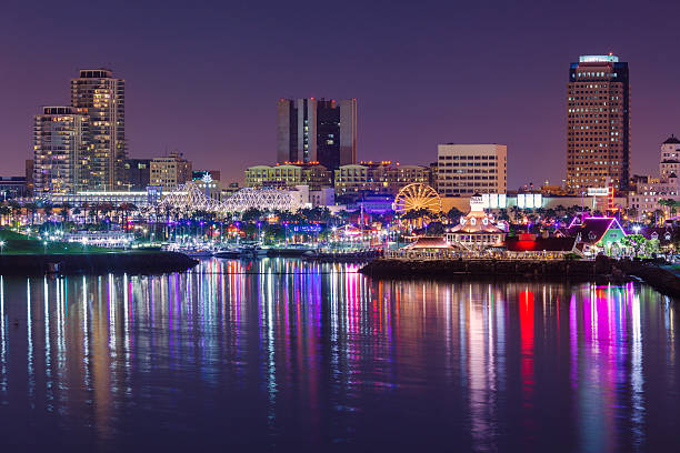 Long Beach skyline by night View towards Rainbow harbor in Long Beach at night. long beach california stock pictures, royalty-free photos & images