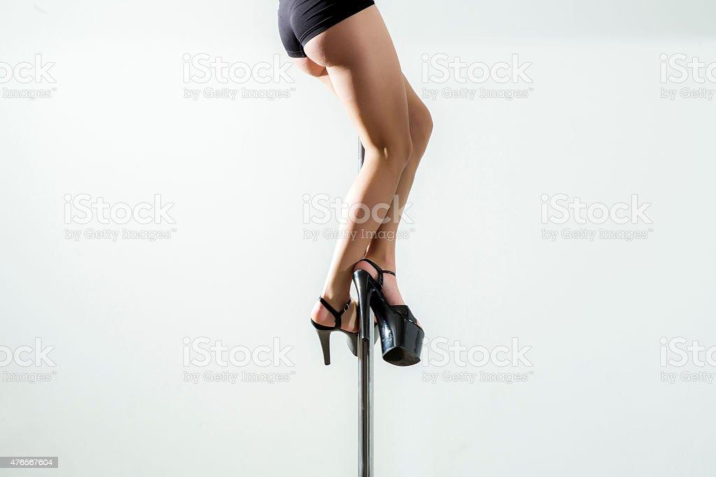 Long beautiful legs of girl on the pole stock photo