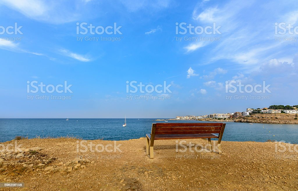 long bench beside the Mediterranean sea royalty-free stock photo