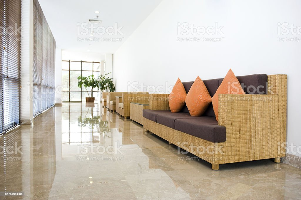 A long big hall with several couches on one side of the wall stock photo