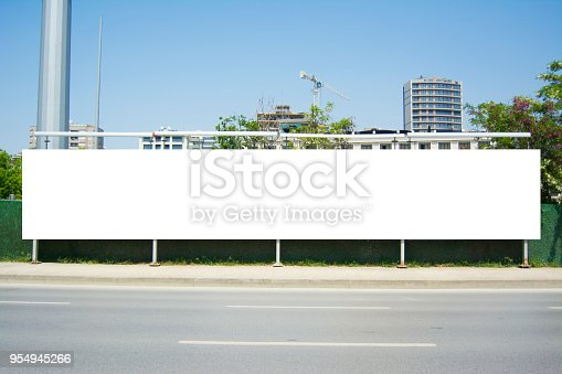 istock Long Billboard Blank Frame mockup 954945266