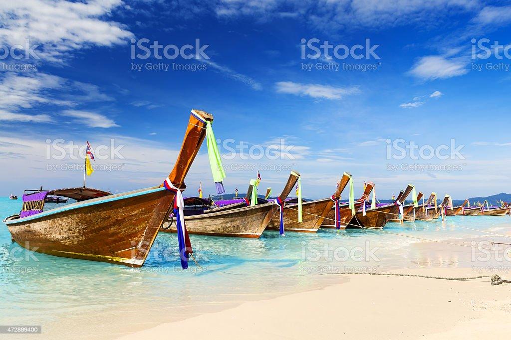 Long boat and tropical beach, Andaman Sea, Thailand stock photo