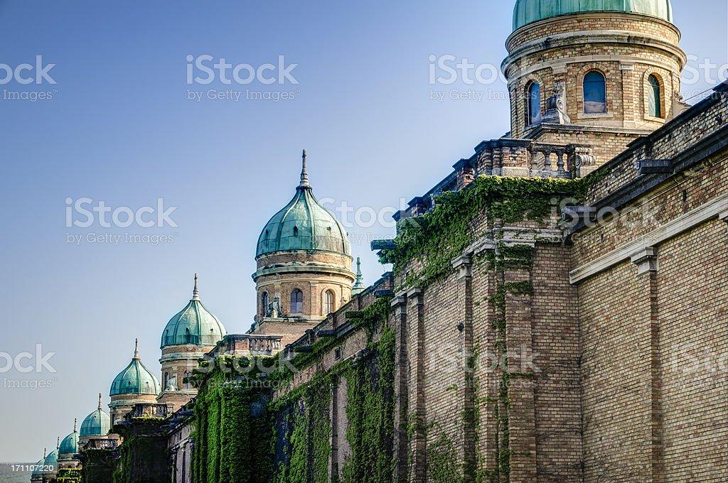 Long brick wall with many domes of the Mirogoj stock photo