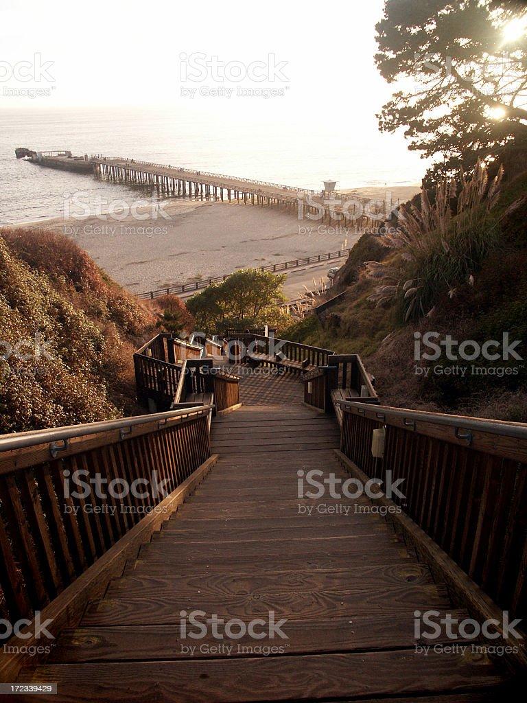 Long bridge leading to the beach stock photo