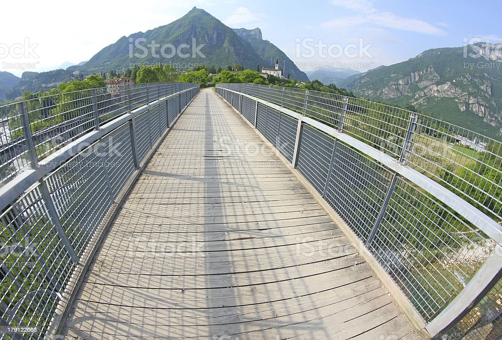 long bridge with a wooden walkway and handrail royalty-free stock photo