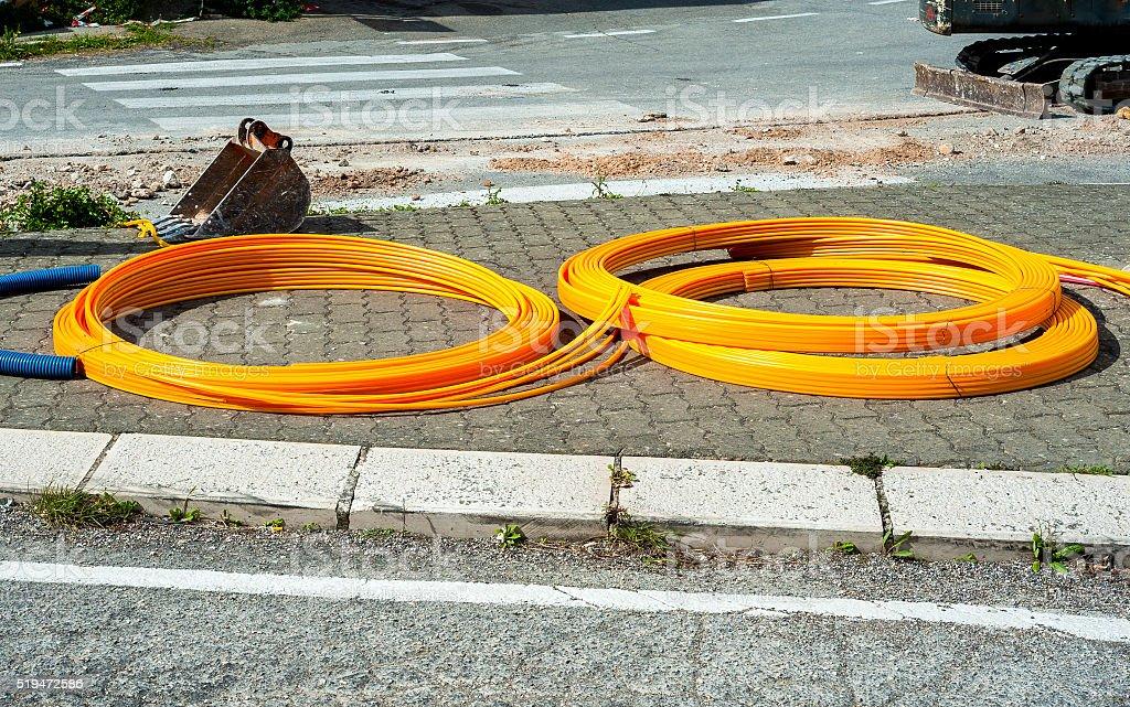 long coils of orange plastic pipes stock photo