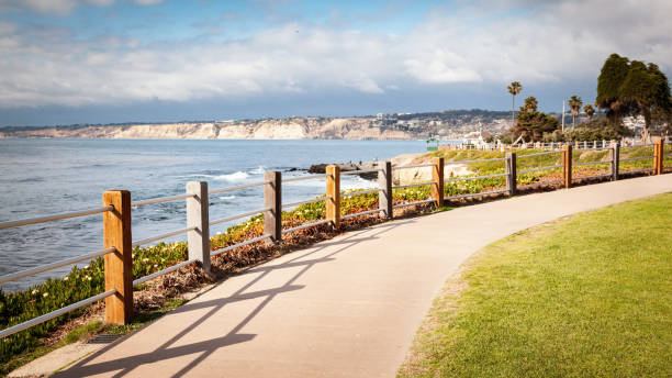 Long concrete path walkway along coastline in La Jolla Cove California stock photo
