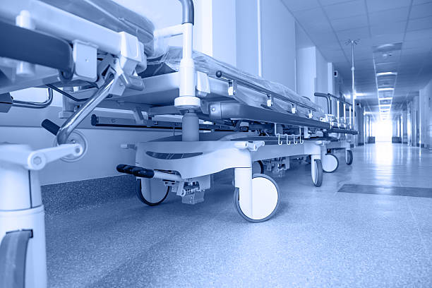 long corridor in hospital with surgical transport stock photo