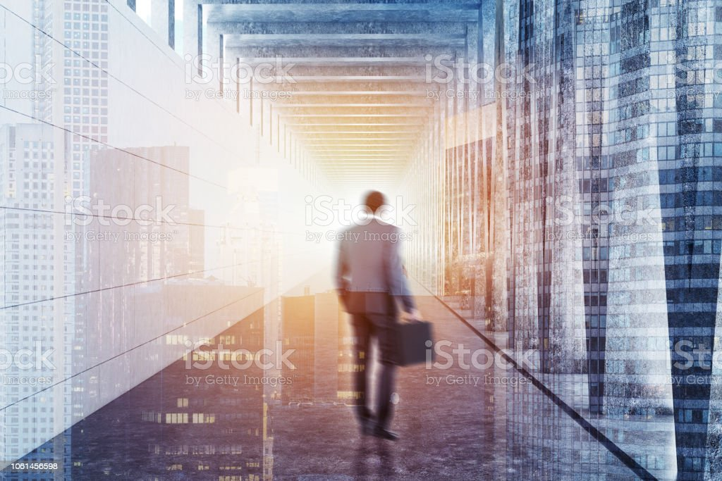 Long corridor with light in the end, businessman stock photo
