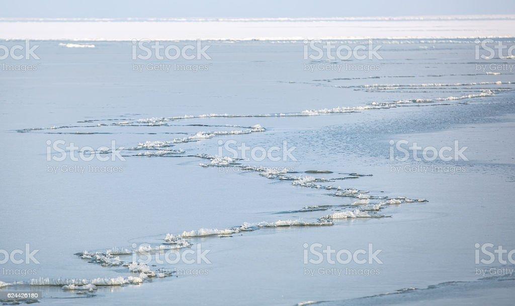 Long crack running along frozen bay of the Azov Sea stock photo