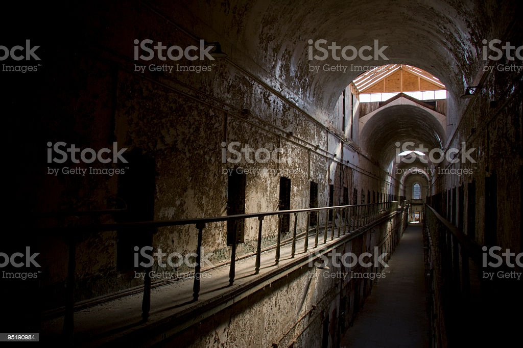 Long, Dark Hallway of Abandoned Prison, Eastern State Penitentiary stock photo