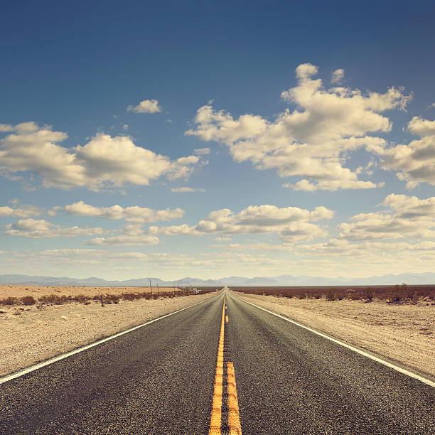 long desert road - midsection stock pictures, royalty-free photos & images