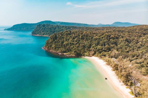 Long deserted beach with white sand and clear water. Aerial top view. Coast of island Koh Rong Samloem, Cambodia stock photo