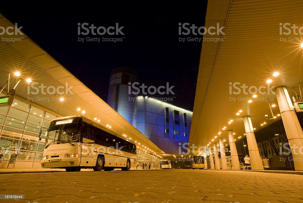 Long Distance Bus Station Illuminated at Night stock photo