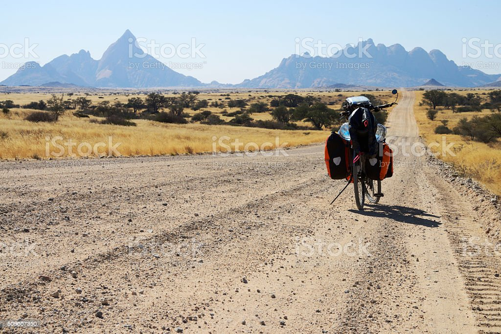Long distance cycling at Spitzkoppe, Namibia stock photo