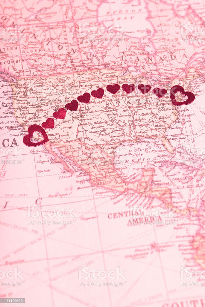 Long Distance Relationship Goes Coast-to-Coast String of shiny hearts connects NYC and LA in a long distance arc across a romantic map of the US American Culture Stock Photo
