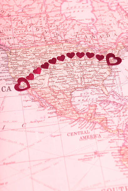 Long Distance Relationship Goes Coast-to-Coast String of shiny hearts connects NYC and LA in a long distance arc across a romantic map of the US long distance relationship stock pictures, royalty-free photos & images