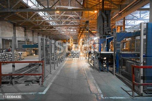 istock Long dusty corridors inside the ceramic factory 1133394430