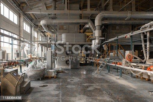 istock Long dusty corridors inside the ceramic factory 1133394435