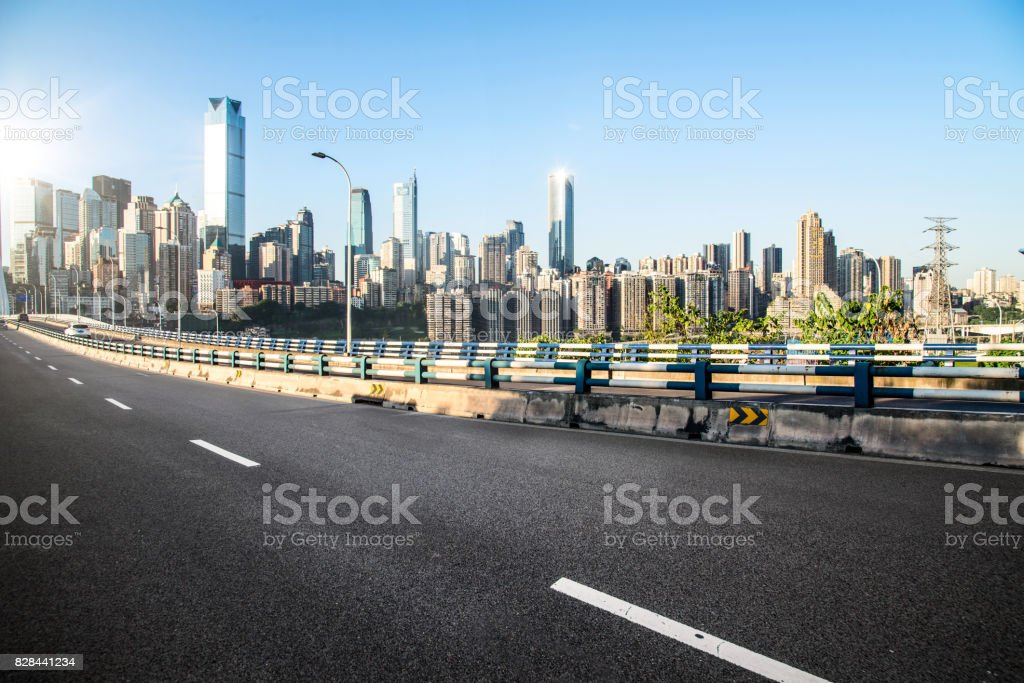 long empty footpath in modern city square with skyline stock photo