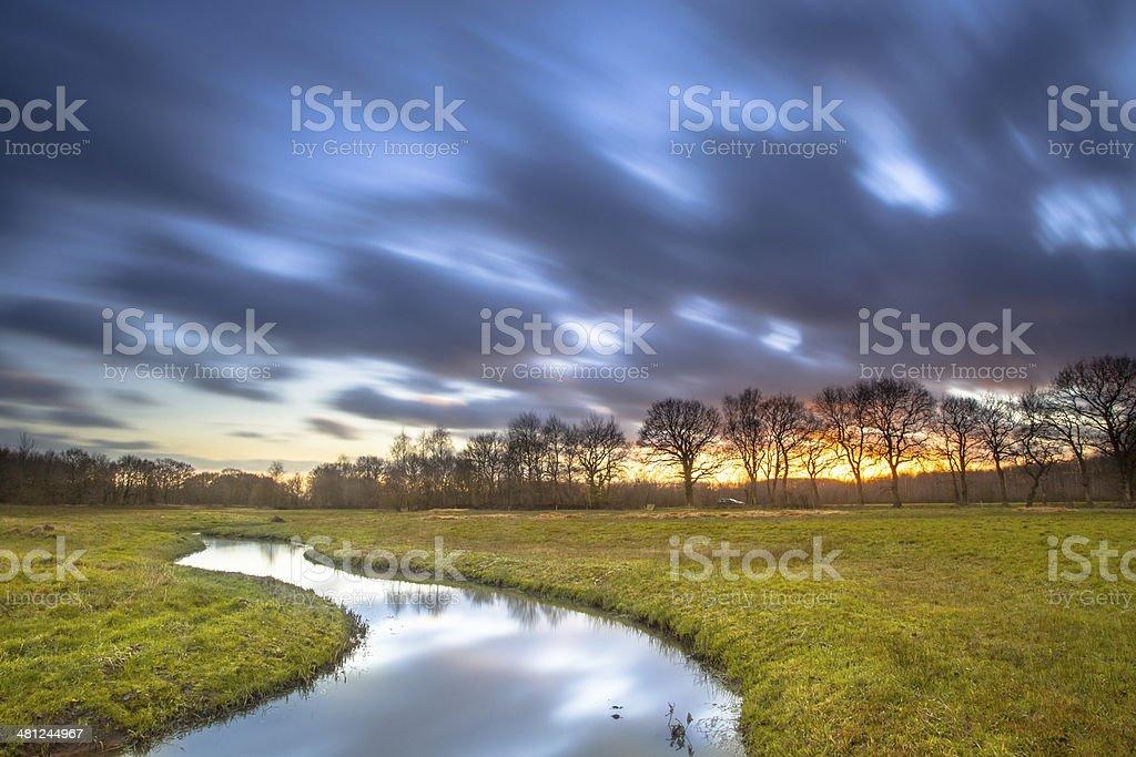 Long Exposue Orange Sunset over River Landscape stock photo