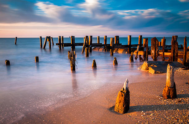 Long exposure at sunset of pier pilings, Cape May, NJ stock photo
