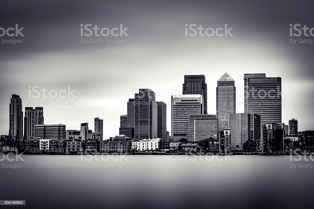 B&W, long exposure, atmospheric image of Canary Wharf stock photo