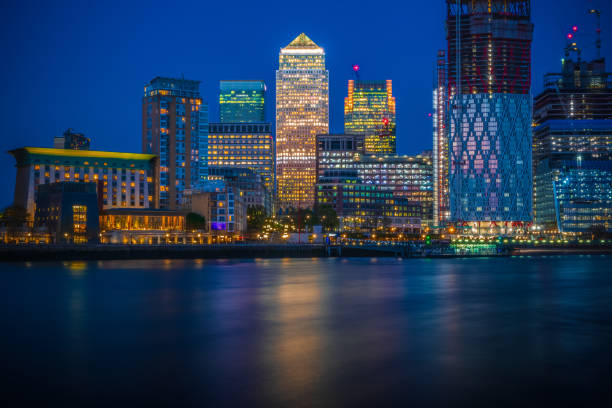 Long exposure, Canary Wharf with new development in London stock photo
