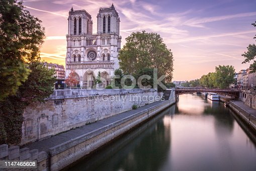 Long exposure: Cathedral of Notre Dame on Seine River at sunrise – Paris, France