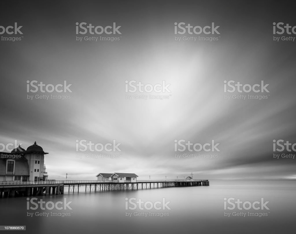 Long exposure clouds over Penarth Pier. stock photo