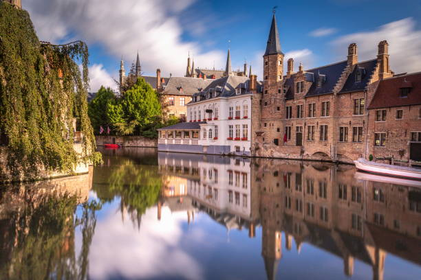 Long exposure Idyllic blurred Rozenhoedkaai at sunrise – Bruges - Belgium Long exposure Idyllic blurred Rozenhoedkaai at sunrise – Bruges medieval old town - Belgium belgium stock pictures, royalty-free photos & images