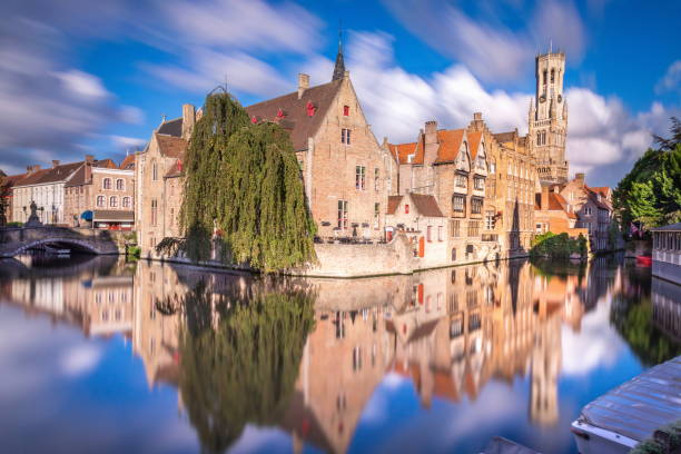 Long exposure Idyllic blurred Rozenhoedkaai at sunrise – Bruges medieval old town - Belgium Long exposure Idyllic blurred Rozenhoedkaai at sunrise – Bruges medieval old town - Belgium bell tower tower stock pictures, royalty-free photos & images