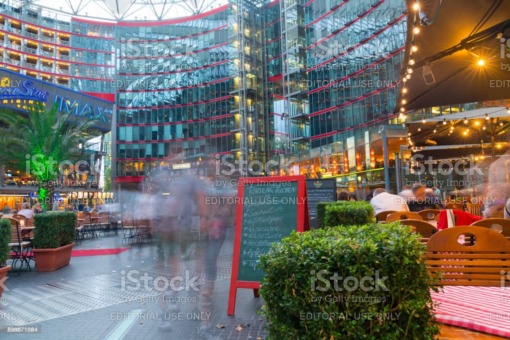 Long exposure in Sony Center courtyard and mall at Potsdamer Platz, Berlin. stock photo