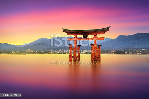 25 march 2019 - Itsukushima, Japan:  Long Exposure photo at sunset with the Floating Torii Gate of Itsukushima Shrine off the coast of Miyajima Island. The shrine dates from the mid-16th century