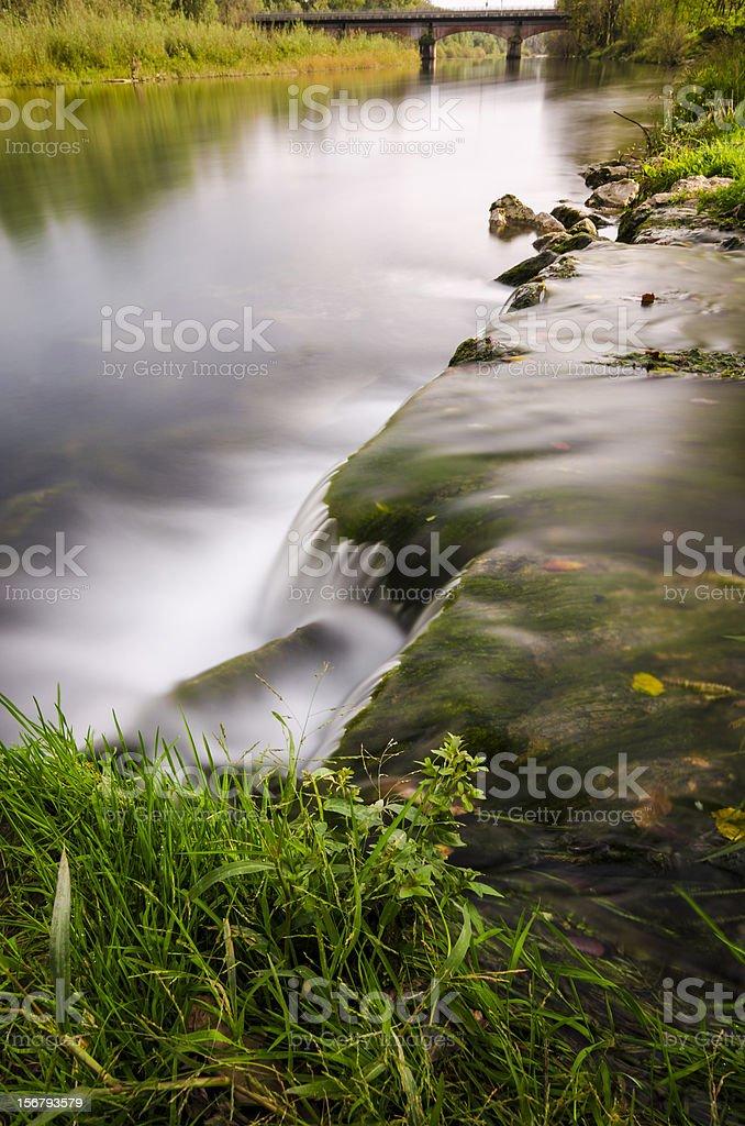 long exposure little watefall sorrounded by vegetation stock photo