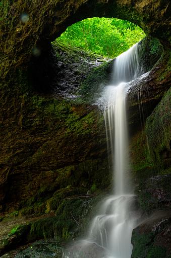 istock Long exposure Murgul Deliklikaya waterfall over brown and green rocks. 1164553363