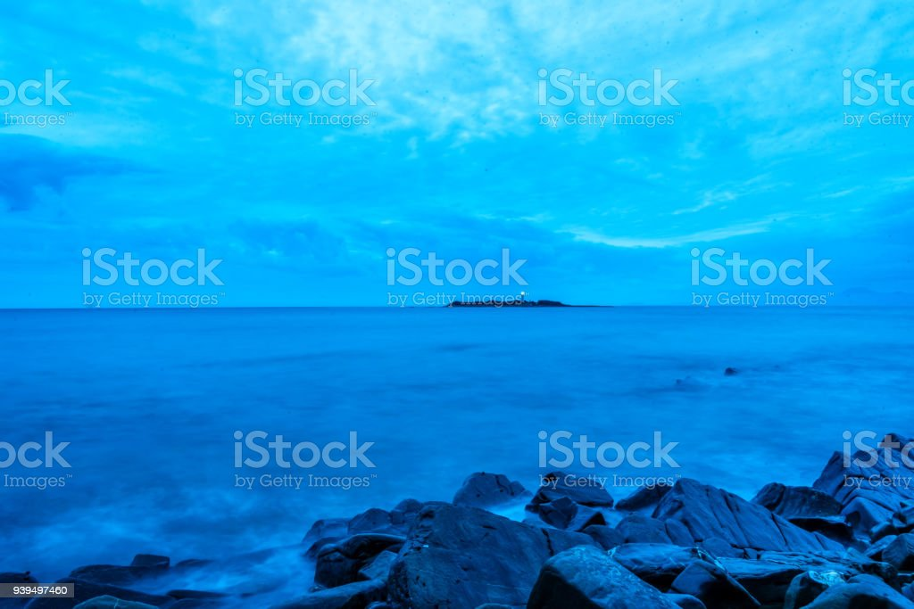 Long Exposure of a Lighthouse on the Southern Italian Coast at Night stock photo