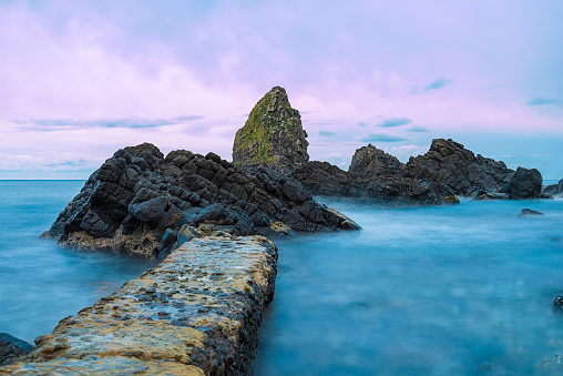 long exposure of Aci Trezza with the cyclopean Islands in the Ionian Sea east coast of Sicily