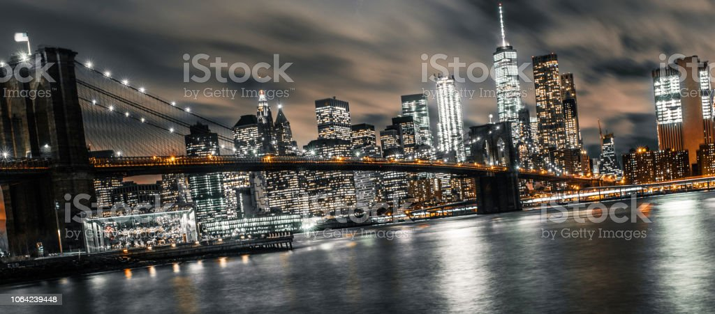 long exposure of brooklyn bridge during a busy evening stock photo