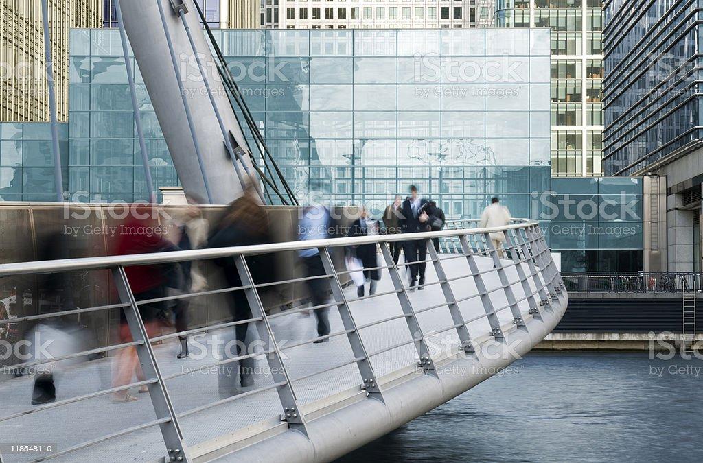 Long exposure of commuters on walkway bridge stock photo