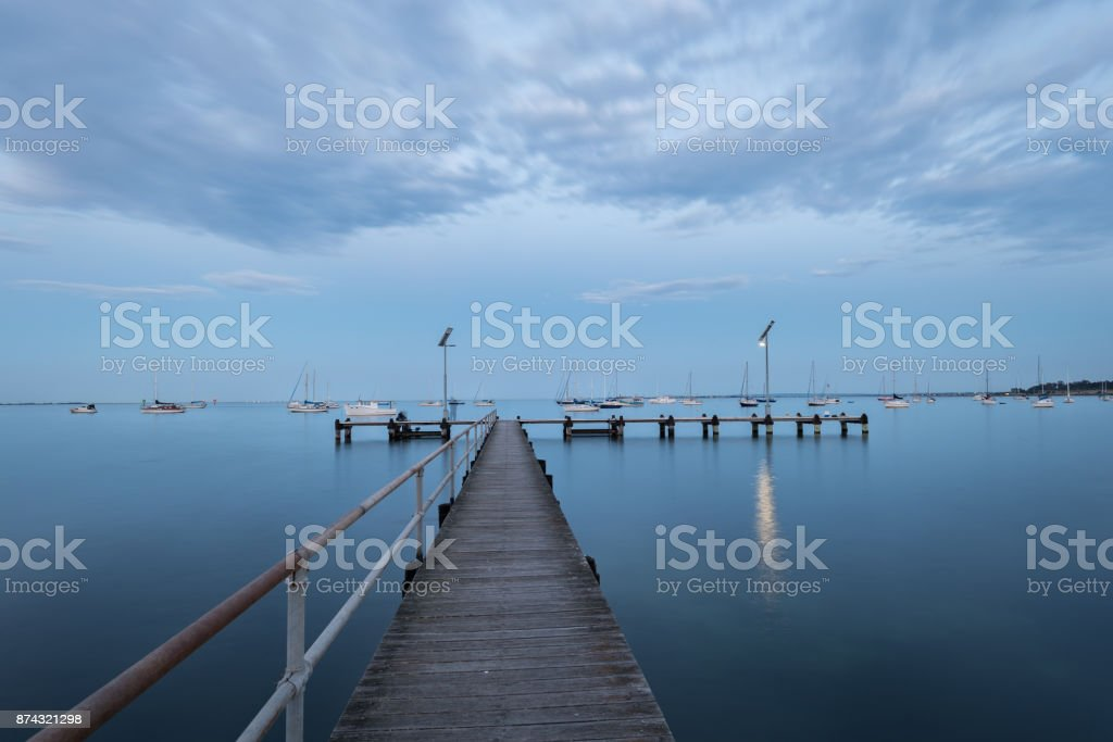 Long exposure of Dusk over jetty in Geelong, Victoria, Australia. This port is so beautiful and located in the central water front. stock photo