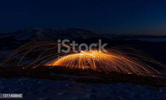 Steel Wool Spinning in snowy mountains.