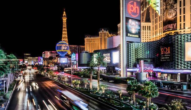 Long exposure of Las Vegas Boulevard near Planet Hollywood and Paris Las Vegas stock photo