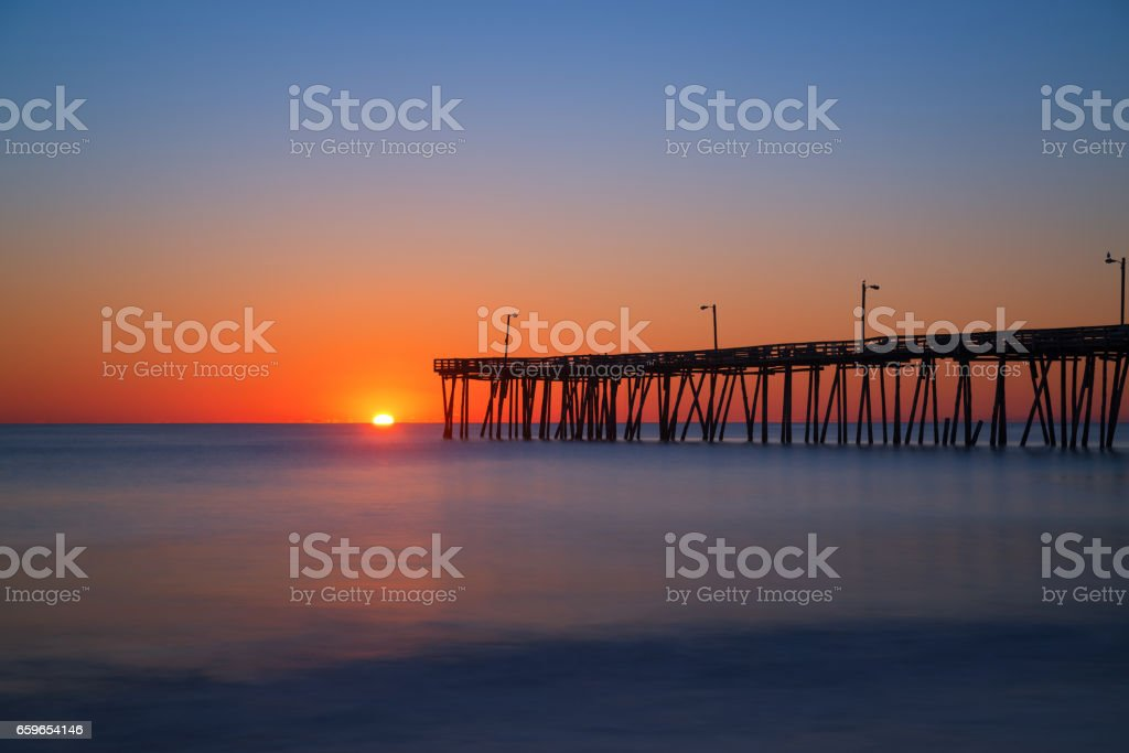 Long exposure of Nags Head Pier at sunrise stock photo