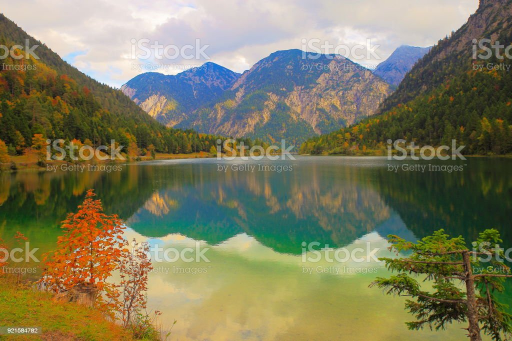 Long exposure of Plansee lake at dawn - Tyrol alps - Austria, border with Germany stock photo