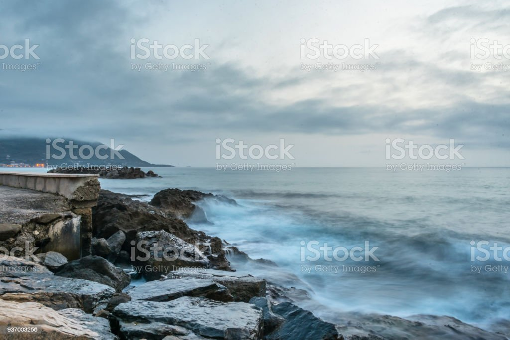 Long Exposure of Rocks and Waves at Night stock photo